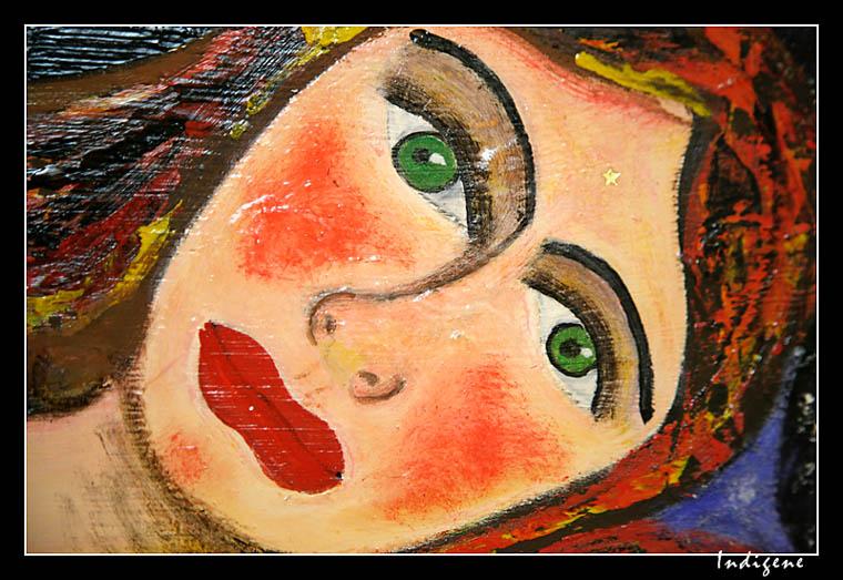 Visage de femme aux yeux verts